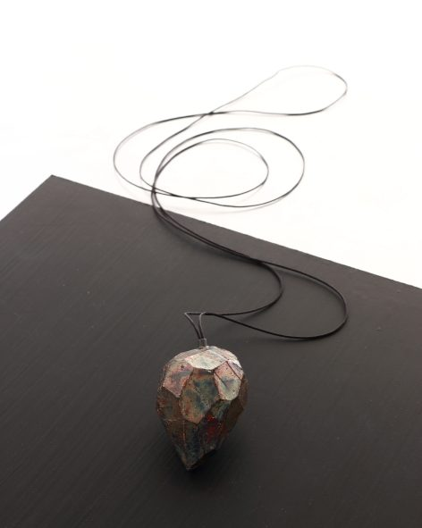 big drop shaped pendant on a long textile necklace. Hand carved balsawood refined with oxidised silver leaf. michelle kraemer jewellery