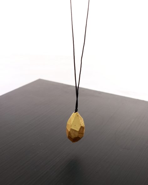 small drop pendant on long necklace. 24k gold plated balsawood on a nylon thread. michelle kraemer jewellery
