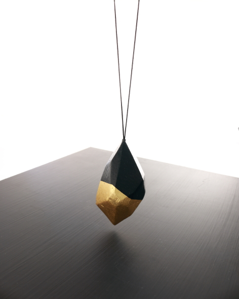 large facetted balsawood pendant on a long necklace, painted black and refined with 24k gold leaf - michelle kraemer jewellery