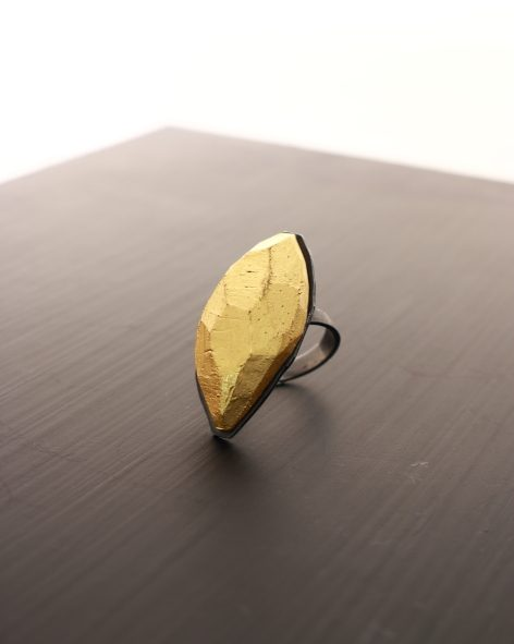oval facetted ring. balsawood refined with real 12k gold leaf on a sterling silver ring shank. michelle kraemer jewellery