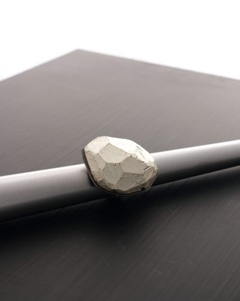 top view of a round balsawood ring with a white gold leaf finish by michelle kraemer jewellery