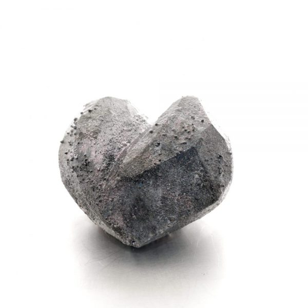 Heart shaped and textured balsa wood brooch in a grey and purple. michelle kraemer jewellery