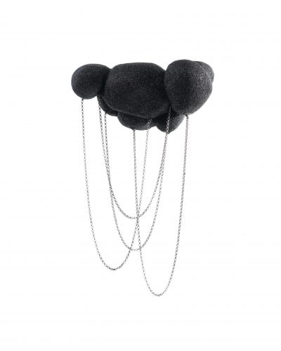 Black balsawood brooch ressembling a black cloud with chain loops dangling from the bottom - michelle kraemer jewellery