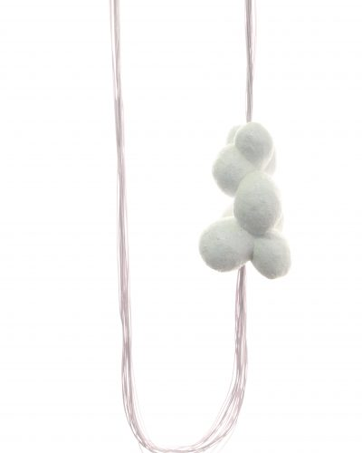 long white necklace with a carved, white, glittery balsawood piece on the side - michelle kraemer jewellery