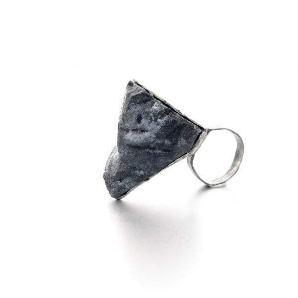 sideview of a rock like ring - black and grey painted balsa wood with oxidized silver