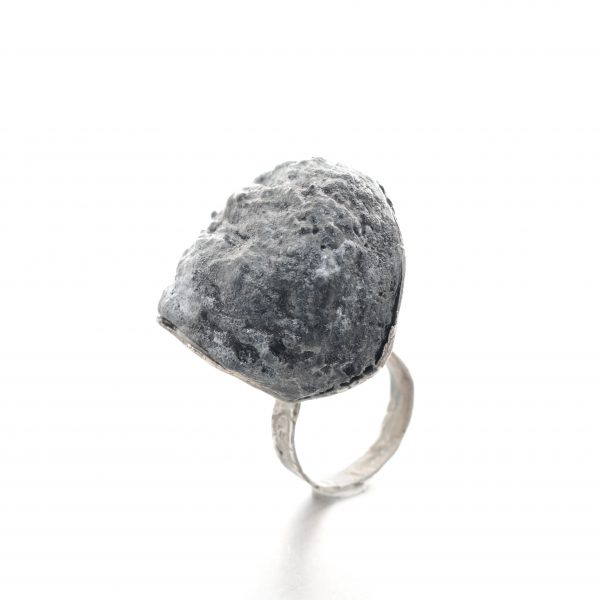 """chunky textured ring with a """"rock"""" in black balsa wood and a textured silver base"""