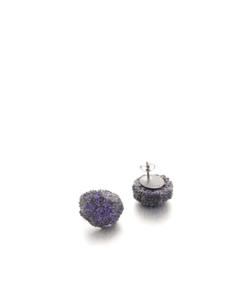 Glamorously edgy earrings with a purple glitter finish, because… you know… a little sparkle never hurts!