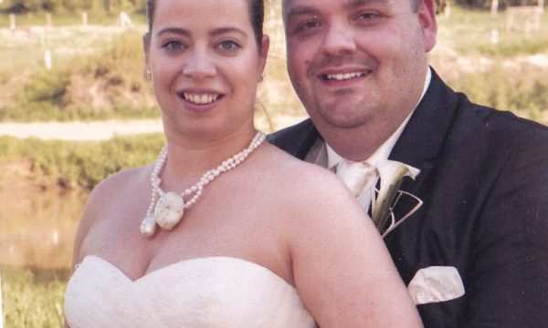 Bride wearing a custom made wedding necklace. The materials are balsa wood, lace from the wedding dress, white gold leaf , Pearls and cubic zirconia. By michelle kraemer jewellery