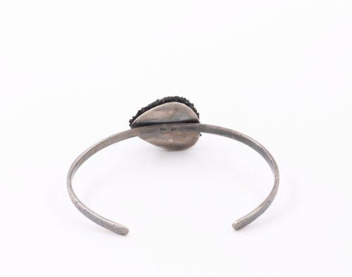 backside of a custom made silver bracelet with a black balsa wood drop shape - michelle kraemer jewellery