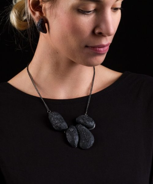 woman wearing large black necklace - michelle kraemer jewellery - photo by Schubert Photography