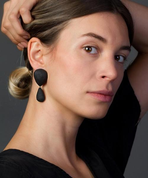 woman wearing large black chandelier earrings - michelle kraemer jewellery - photo by Schubert Photography